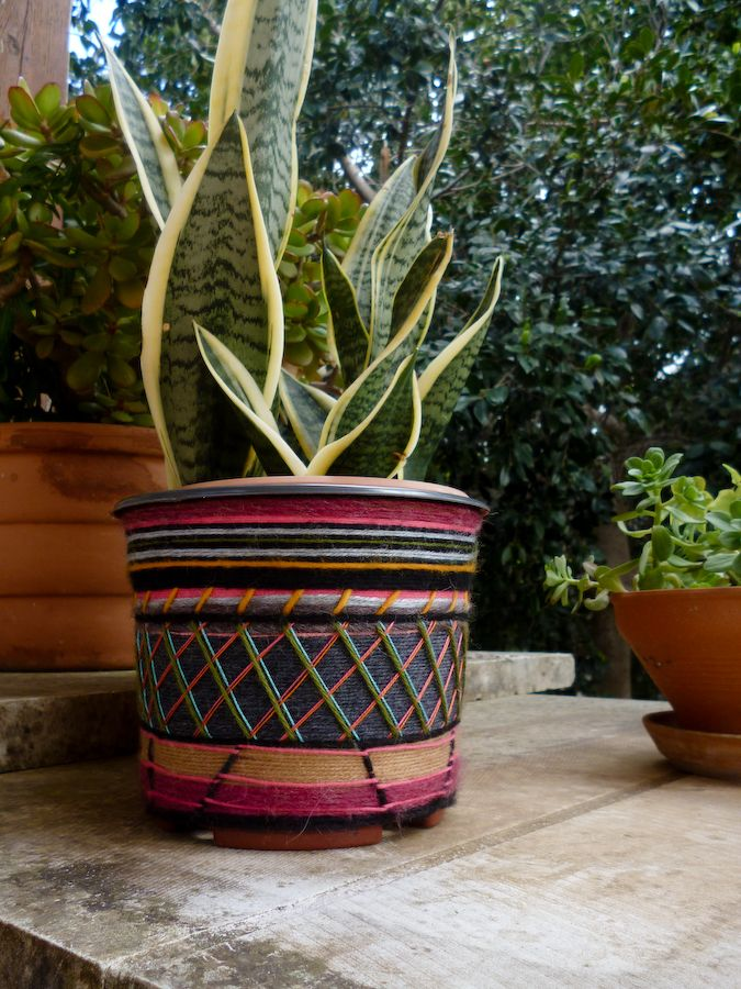 Upgrade plain pots with easy-to-do, no-cost yarn detailing.
