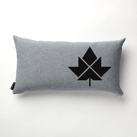 Inspired by barn quilts in South Eastern Ontario, this pillow features a geometric maple leaf. Reverse denim with non-toxic black print