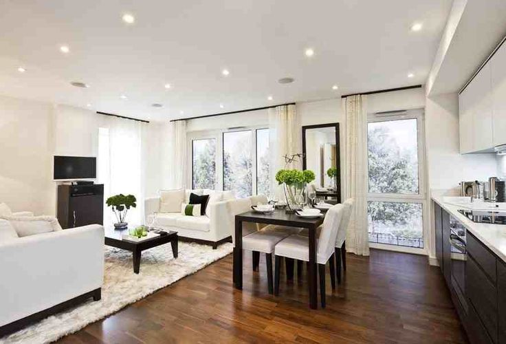dark and light colours make this open plan living, dining and kitchen