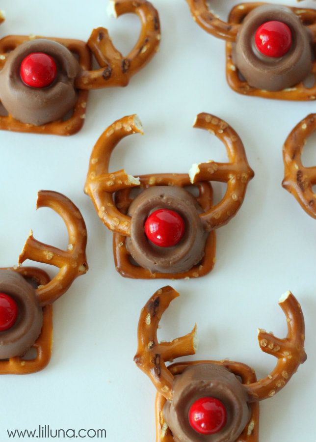 Rudolph Treat INGREDIENTS: * Square Pretzels * Regular Pretzels *Rolos **Red Sixlets ...Preheat oven to 230. Place parchment paper on a cookie sheet. Put down square Pretzels and then un-wrapped Rolos.  Place cookie sheet in the oven for 2-3 minutes. Take it out and insert pretzel antlers at the same time. Then add the Red Sixlet for the nose!