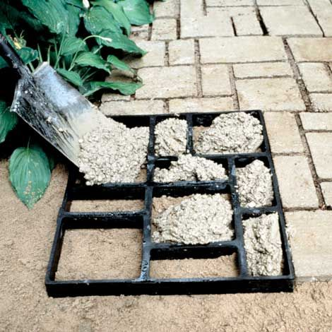 "With a few bags of pre-mixed concrete, you can enjoy a block style pathway. The 2' x 2' recycled plastic forms are in the shape of stones or bricks. Simply ready the ground by removing approximately 1"" of soil, fill the cavities of the Pathmate with wet concrete, and trowel the surface smooth. After about one minute, the mold can be moved to the next spot. Each section makes 4 square feet, is 1 3/4"" deep, and uses one 80-lb bag of concrete."