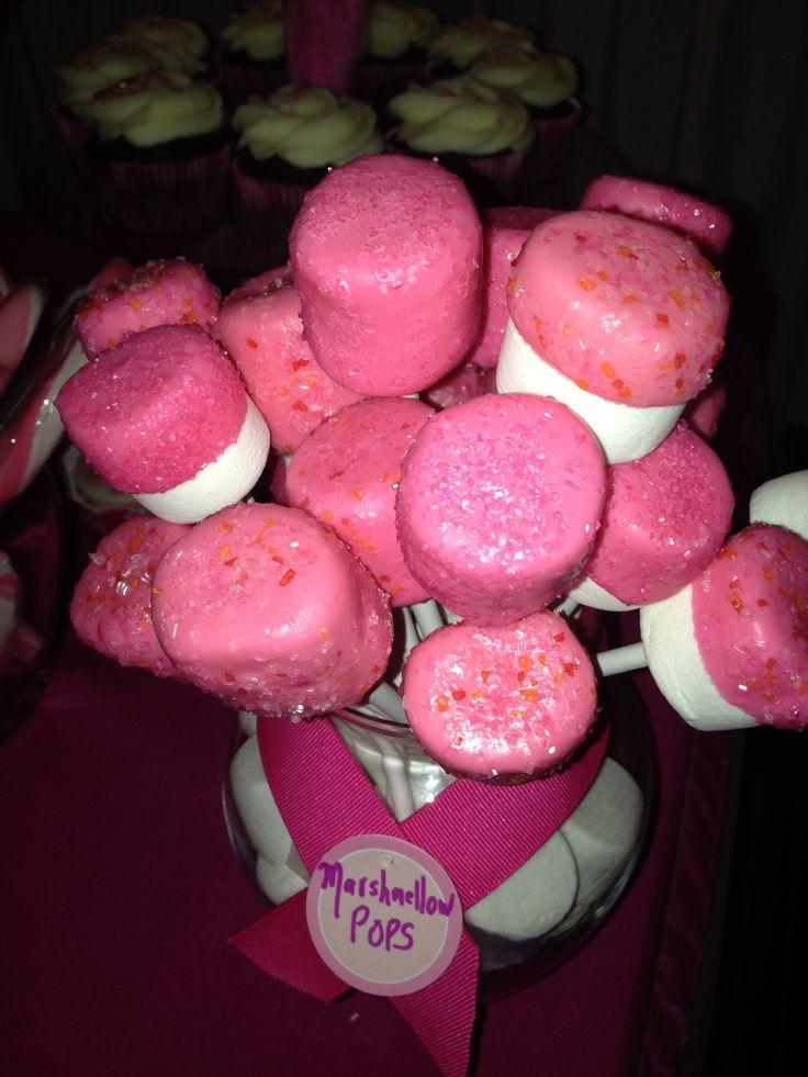 Marshmallows dipped in pink chocolate