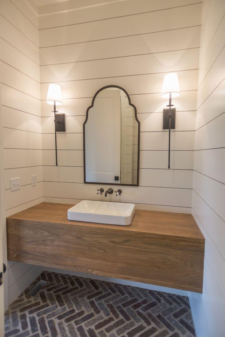 powder bath with herringbone brick floors and custom