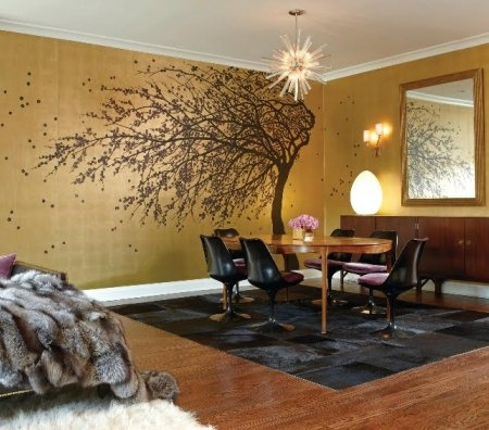 Metallic Gold Accent wall with tree in the living room