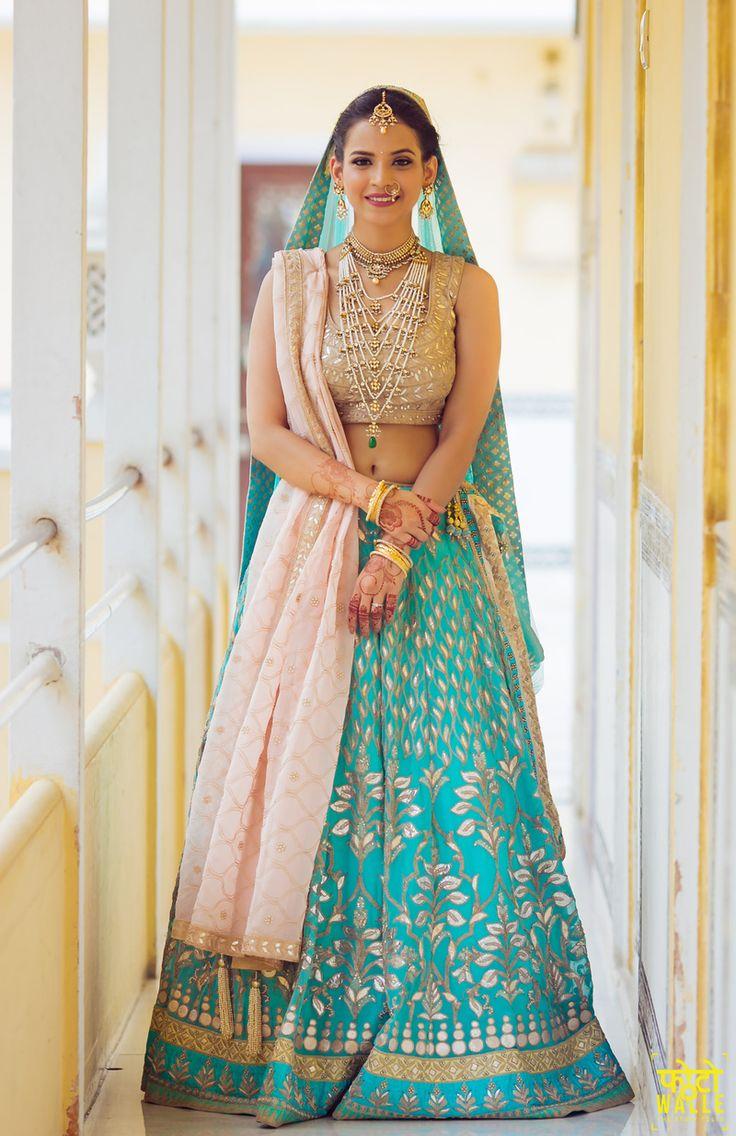 Bride in Light Blue Lehenga with Gota Work and Satlada