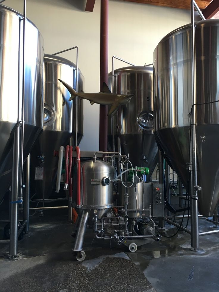 Yellowhead Brewery brewmaster has long history with craft beer, by Amanda Sutherland  | The Local Good | Craft beer tanks at Yellowhead Brewery downtown Edmonton. Photo: Amanda Sutherland. | #yegfood #yegbeer