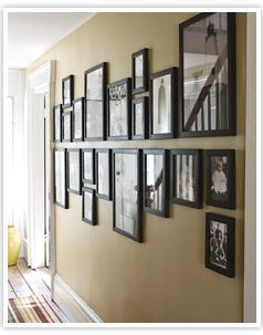 Line them up. For a fool proof way to have your photo wall looking picture perfect, line up all the bottoms or the tops of the picture frames (whichever you prefer).  If you are looking to hang a large number of photo's, create two rows with the top picutres lining up along the bottom and the bottom pictures lining up at the top.  This essentially creates a straight line down your wall. Here is a photo that explains this much better than I ever could!