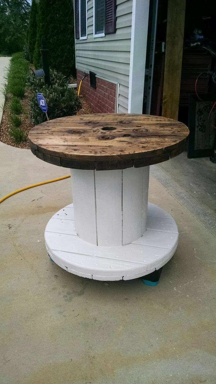 Recycled cable spool for pool side table, even holds umbrella in the middle