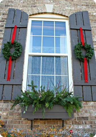 Thrifty Decor Chick: Festive outdoor decor - My husband would LOVE for me to tack them down so they don't blow all around. Loop the ribbon at top to wrap it around our lights beside the garage?