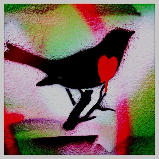 Bird with a heart.