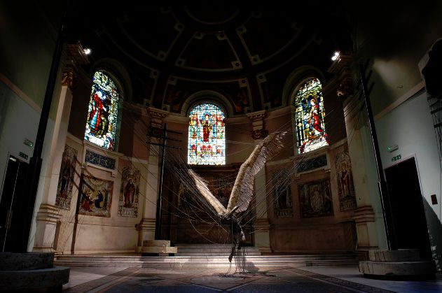 3) ex0skeletal: Lucifer (Morning Star) by Paul Fryer  (Installation in the Holy Church in Marylebone, 2008. Anodised aluminium, silicon rubber cord, wax work figure, feathers/aluminium, concrete.)