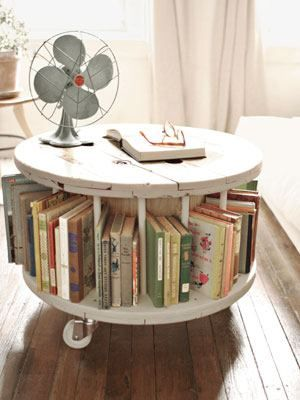 Recycled Large Wooden Spool As Book Storage And Rolling Table. It'd be so cool to put a cushion on top and have a little seat!!
