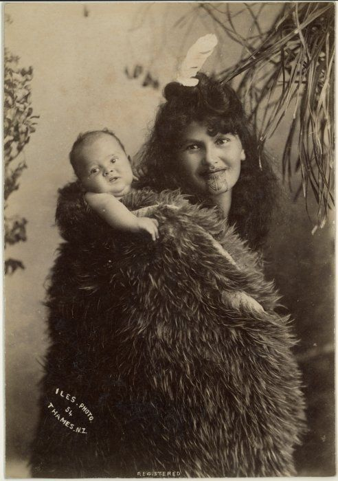 Maori mama, New Zealand. This is how my grandmother carried my mother. My mother remembers riding on her mothers back while her younger sister rode on the front. I am a babywearer like my grandmother was before me...