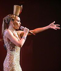 Kylie Minogue - diagnosed with breast cancer in 2005 at age 36 - still dancing