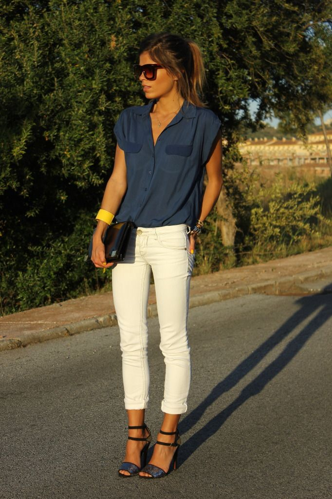 Cute outfit - I'm ready for white jean weather. Love the pop of color on her wrist. love the combo of white skinny jeans and navy blue top :)