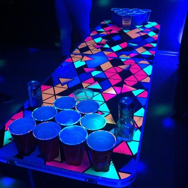 "Beer pong table; ""The Brothel"" painted in neon colors with black lights in basement..."