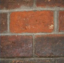 How to clean brick: Apple cider vinegar and water! Going to have to try this...