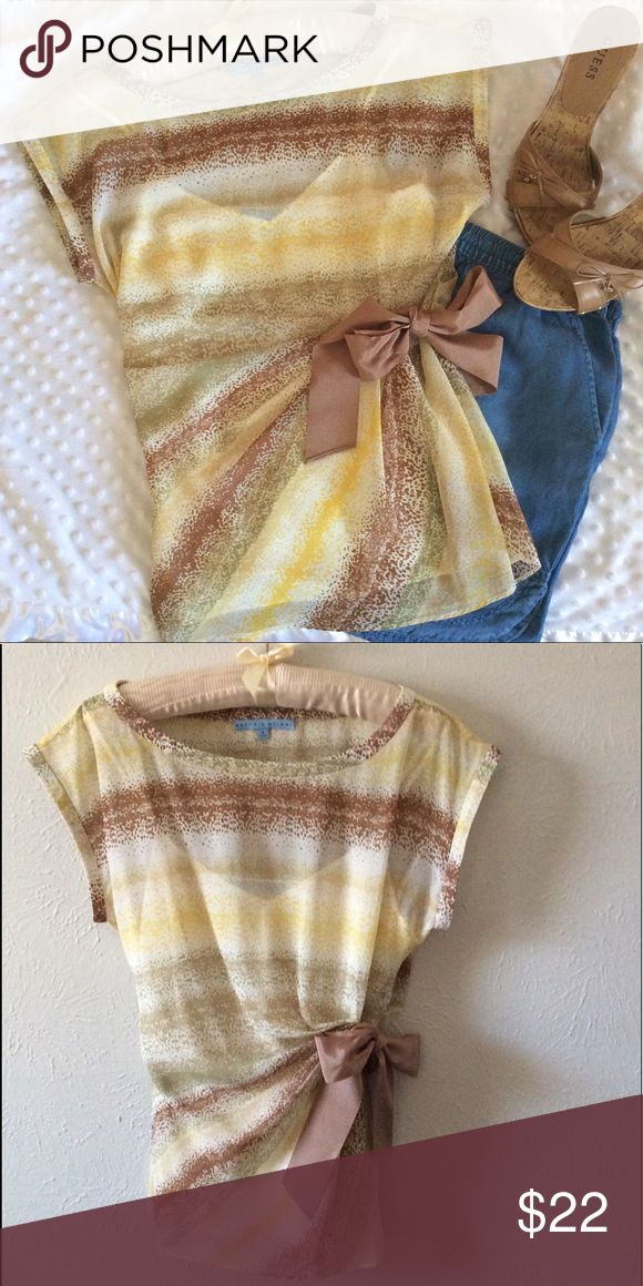Antonio Melani Blouse with Cami Watercolor-like multi colour print: light brown, yellow, light green; cap type sleeve, rouching and side tie, straight hem. Snap stays hold the coordinating, cream coloured camisole in place. Beautiful condition, worn only a couple of times. ANTONIO MELANI Tops Blouses
