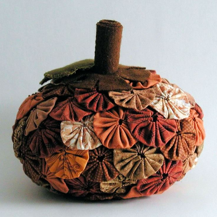 This is a yo-yo covered pumpkin .It was a  custom order for an Etsy customer. I just love yo-yos, don't you? The pumpkin itself is a large yo-yo that's been stuffed and then covered. The smaller yo-yos are attached with thread and a little fabric glue.