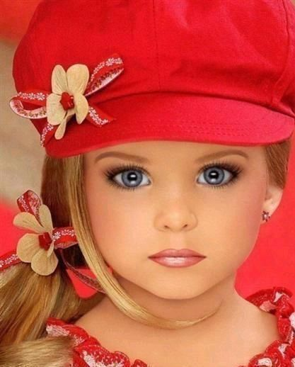All grown up! Toddlers & Tiara's - reminds me alot of JonBenet` Ramsey lost December 25, 1996, at six years young. This lil beauty doesn't look real.