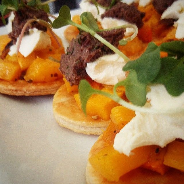 Canape - Roast Butternut and Chevin Goat's Cheese Tart with Calamata Olive Tapenade and Pea Shoots