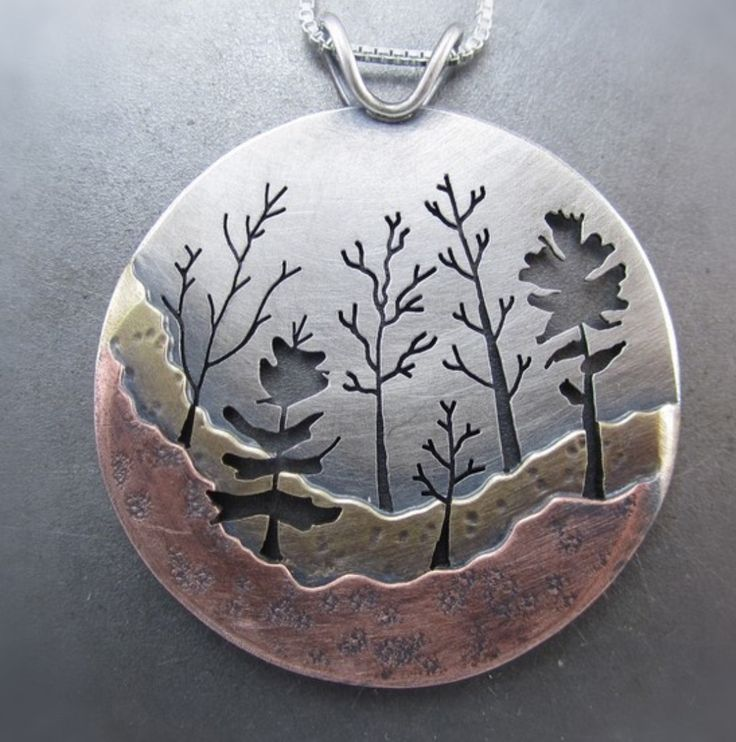 i like this pendant because i like how he makese the tress out of negative space and i would like to use the space like that in my pendant