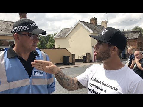James Aspey debates justice with a police officer outside of a slaughterhouse. #vegan #vegetarian #glutenfree #food #GoVegan #organic #healthy #RAW #recipe #health #whatveganseat