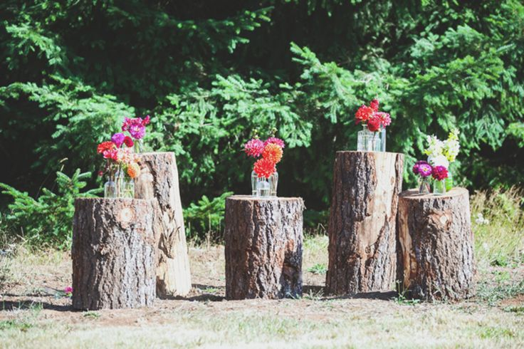 Tree Stumps AND Hay Bales for seating. White mums will be in season. Some shepards hooks for hanging mason jar lighting.