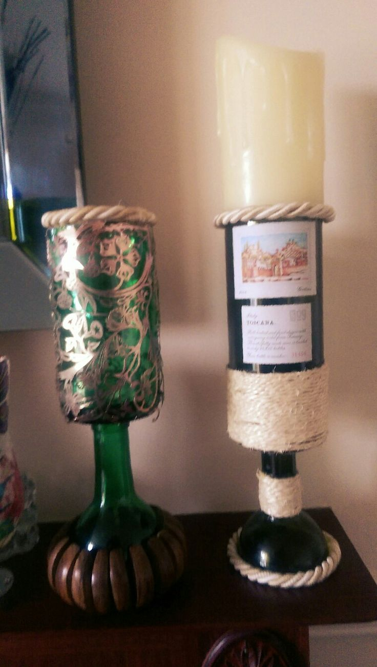 Wine bottled, cut and decorated and now made into candle holders.