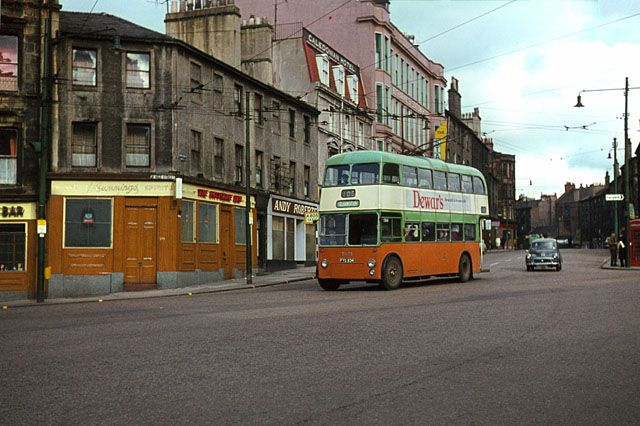 Cowcaddens Cross - A trolleybus on service 105 turns from Cowcaddens into West Nile Street towards the City Centre, whence it will continue to the southern suburb of Clarkston. this was the very last day of trolleybus operation. Not only the trolleybuses are no longer there, not a single building visible in this picture has survived, and the road junction has been altered. As a result the precise location of this view cannot be determined.