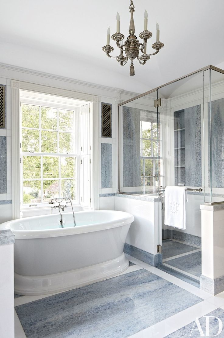 Susanne's bath features a chandelier from Remains Lighting, a  Greenberg-designed shower, and