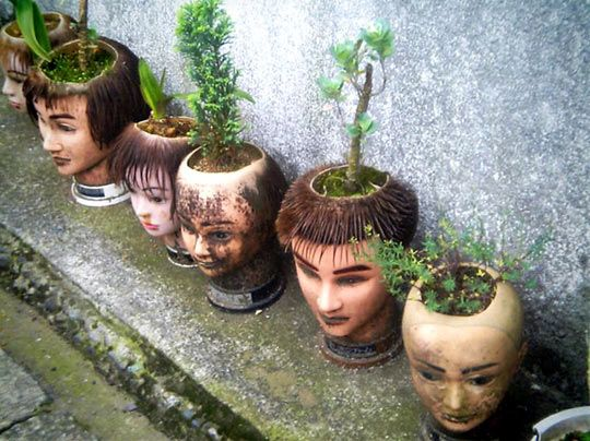 Planters made from beauty school practice heads! - ROMEO - now I want all my manikin heads back!