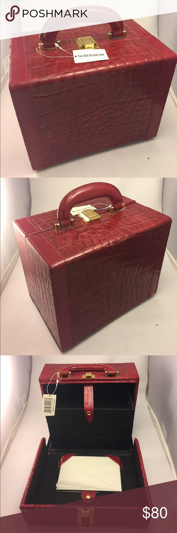 Nordstrom Burgundy makeup Bag!! NWT!!! 😍❤️ Never been used makeup bag and the mirror is still wrapped in tissue paper. This bag will hold your makeup and be super cute to carry around for any travel excursion near or far!!! 😮 Nordstrom Makeup Brushes & Tools
