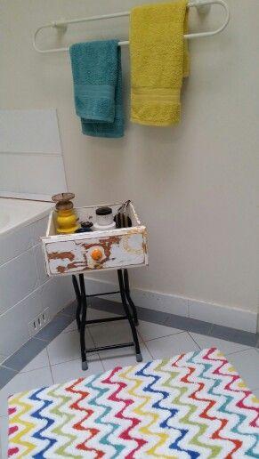 A discarded shelf to a useful bathroom storage asset
