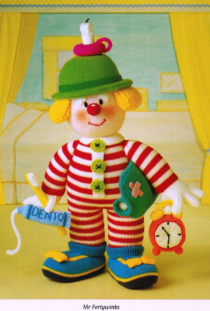 """From 'Knitted Clowns', Pt.1 of Jean Greenhowe's 'Red Nose Gang' collection meet the ready for beddy Mr Fortywinks. He is knitted with DK wool and stands 30cm/12"""" tall (excl. hat decor). He has all he needs to get a good night's sleep, then wake up all refreshed and ready to go. Designed and published by Jean Greenhowe Designs in 1992."""