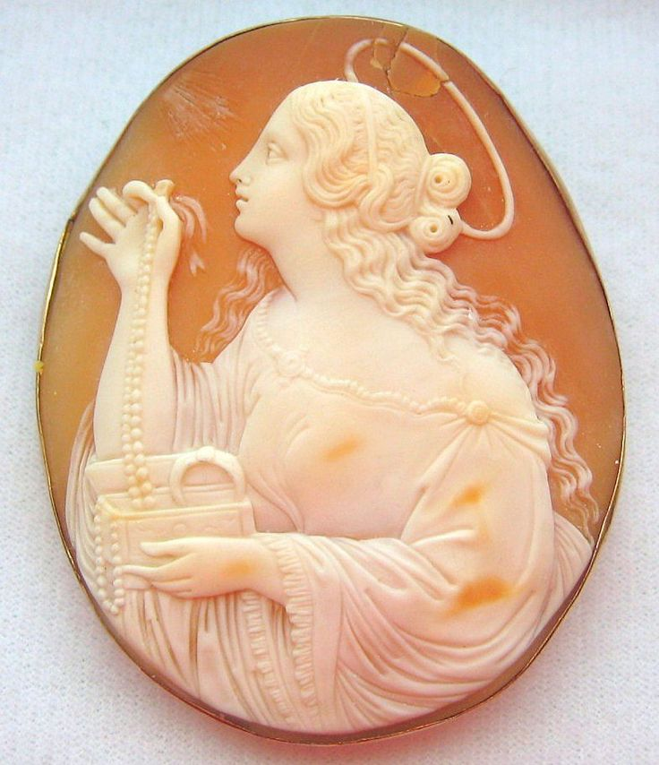 Woman with Jewelry Box  |  carnelian shell, gold brooch  |  Victorian