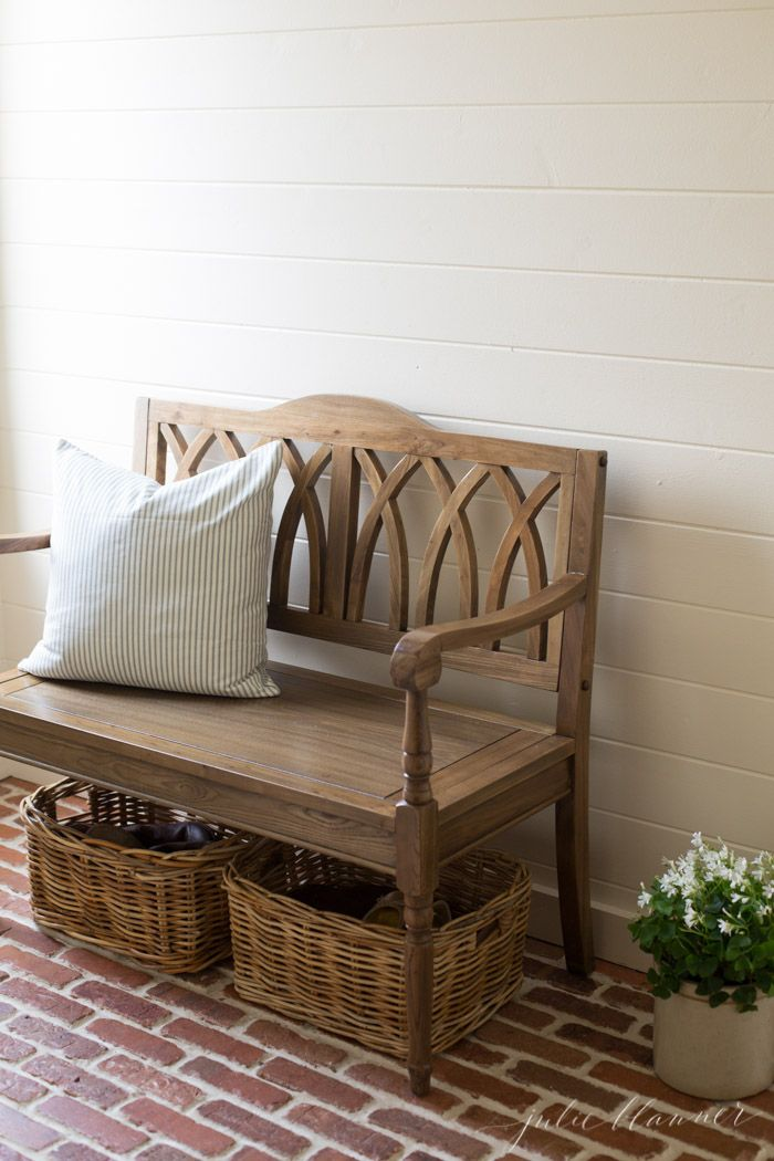 entryway with brick doors shiplap walls and wood bench