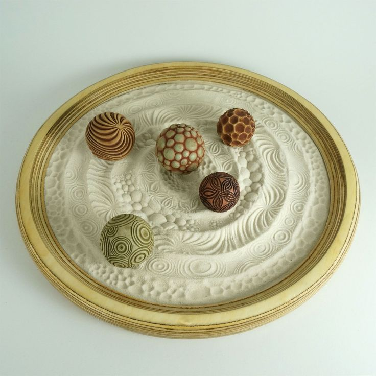 Tabletop Modern Zen Garden: For the love of circles! Create a Sand Mandala with our cement zen balls. Or, stamp and roll the sphere patterns to make cool sand trails. Each cement ball has a different circle pattern. A perfect gift for that hard to shop for person. These sand tray sets are truly unique!