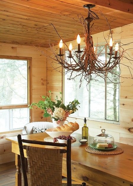 Create your own version of the popular twig chandelier.    Designer Barb Purdy dressed up an inexpensive fixture with pliable young twigs, which she tied at the top and around each light with thin black wire to form organic-looking branches. The bulbs were dipped in silicone for a softer, aged effect. You can also spray paint your entire chandelier white for an on-trend look.