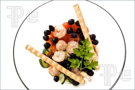 Picture of Food & Drinks - Mediterranean Recipes - Shrimps salad with black olives, cherry tomatoes, cucumber and breadsticks. Isolated on white background.