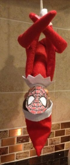The Elf on the Shelf Ideas: Have it dress up as your kid's favorite super hero!