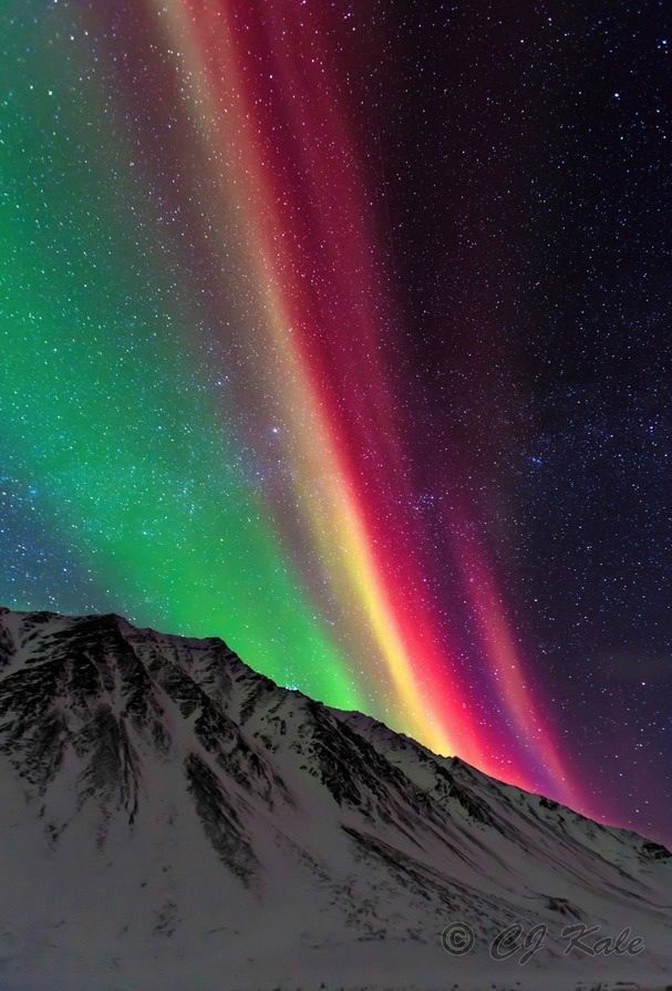 It almost looks like a rainbow at night. But it's not. It's called aurora!
