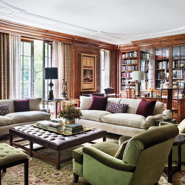 Design firm @sawyerberson devised this handsome library, complete with  walnut bookcases and paneling,