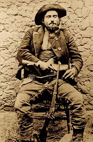William Whitney Brazelton {?- 1878} was an outlaw and stage Robber of the wild West. Brazelton was killed by a five-man posse two miles south of Tucson, Arizona August 22, 1878. He had two cartridges belts; two pistols; a Spencer rifle, his mask, earrings from his last robbery and a gold watch and chain.