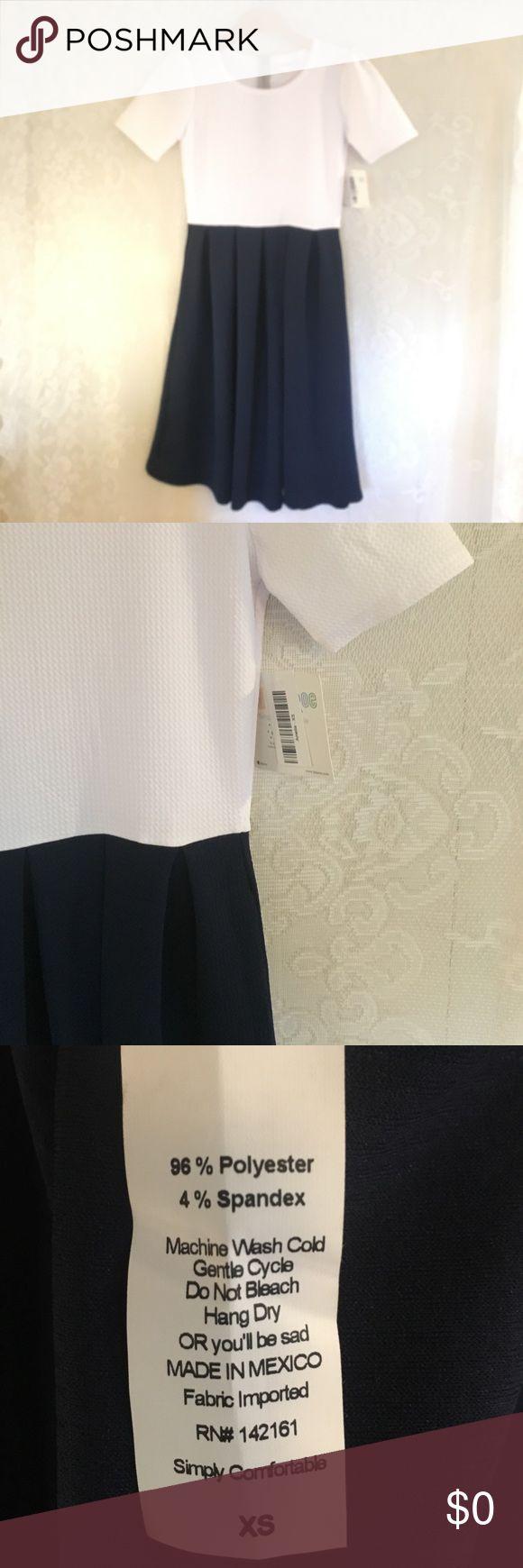 New! LulaRoe Amelia White & Navy New! LulaRoe Amelia White & Navy LuLaRoe Dresses