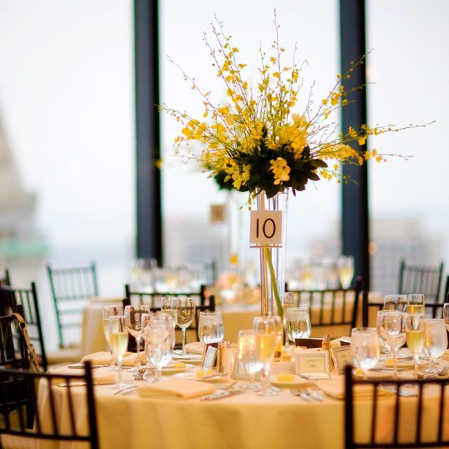 Black and Yellow Flowers Tall Centerpiece | -colored linens topped the tables beneath tall arrangements of yellow ...