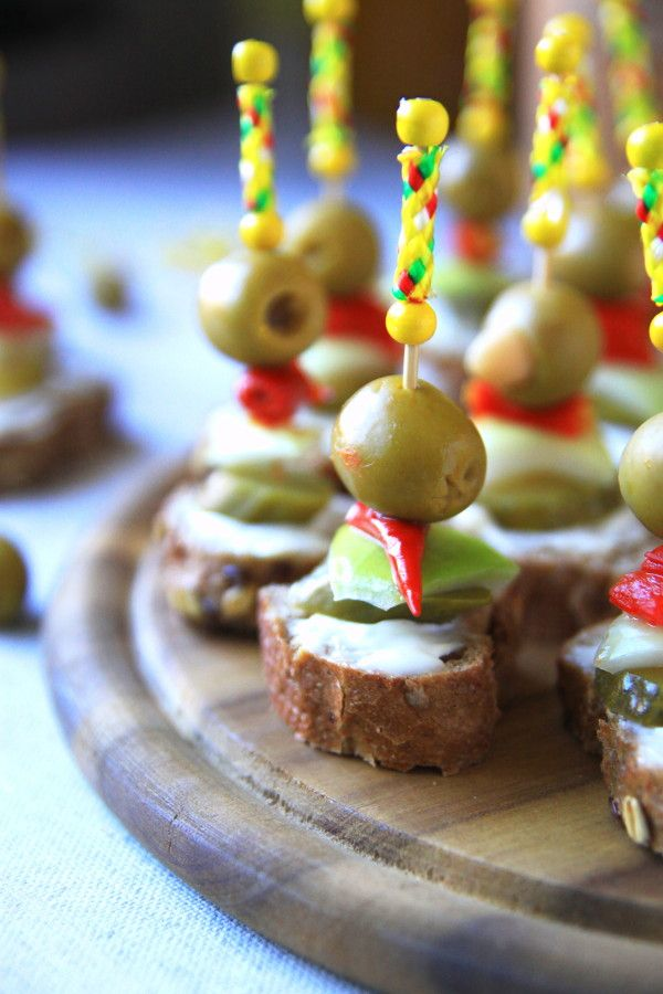 Small Party Snack Olives with a vegetables and baguette on a Foodpicks