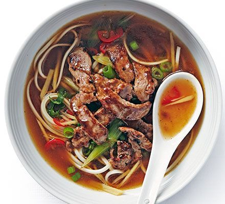 Thin strips of sirloin steak coated in sticky oyster sauce make an impressive topping for this dish of egg noodles in a fragrant broth