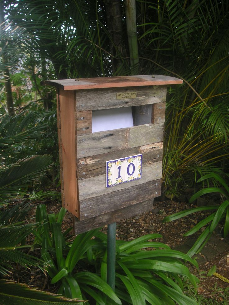 Our new letterbox: recycled fence palings, ceramic numbers from Portofino, Italy.