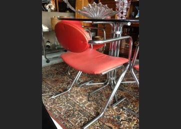 Juego de 5 sillas en rojo y tubo de acero,años 50
